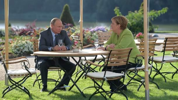 Прагматичное сближение: западные СМИ о результатах встречи Путина и Меркель