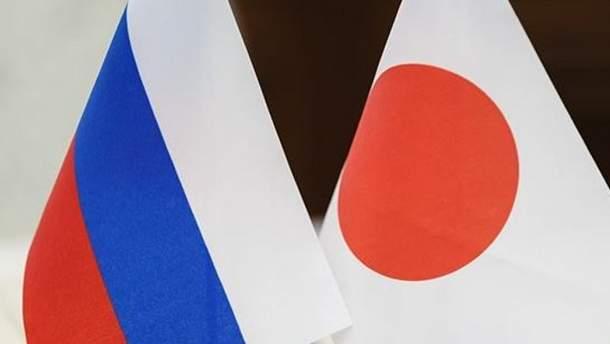 Прапори Росії та Японії