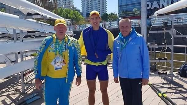 Іван Тищенко (у центрі) став переможцем юнацької Олімпіади