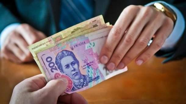 Должностные лица Донецкого облавтодора требовали взятку в размере 300 тысяч гривен