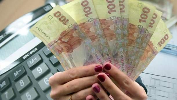 Украинцы впервые получили субсидию наличными