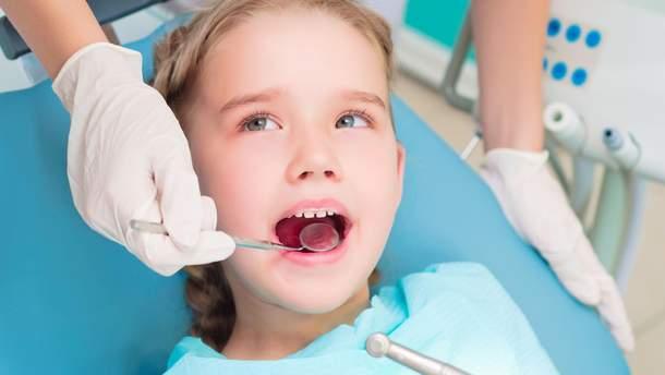 Чому темніють зуби у дітей