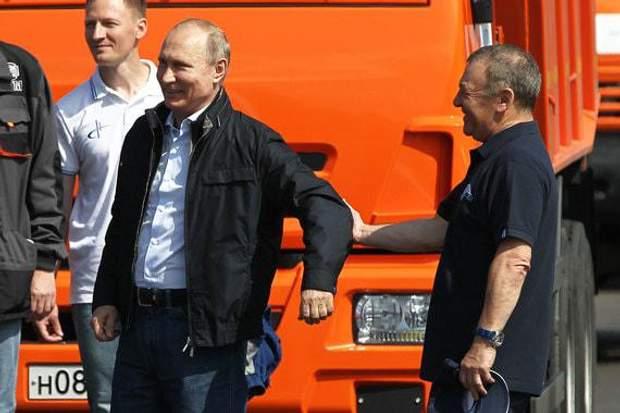 Путін та Ротенберг (на фото – праворуч) на відкритті Кримського мосту