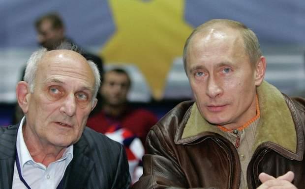 Путін з тренером Анатолієм Рахліном