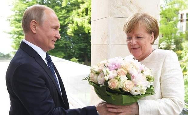 Меркель Путін війна на Донбасі