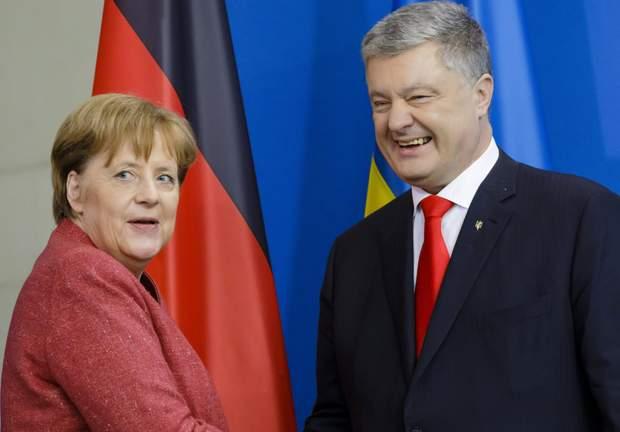 меркель порошенко вибори