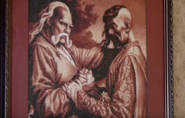 На стінах – картини з козаками