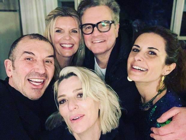 Колін Ферт та Лівія Джуджоллі на новорічній вечірці