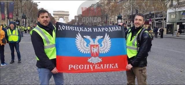 Приспешники оккупантов во время протестов «желтых жилетов» развернули в Париже флаг ДНР: фото