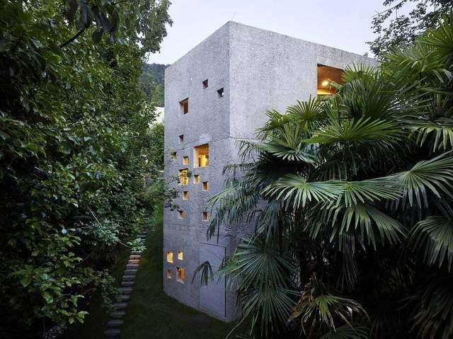 Сплошной бетон: современный дом из Швейцарии, который внешне напоминает склад – фото