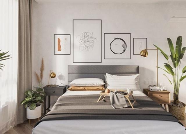 Интерьер в спальне достаточно сдержанных оттенков