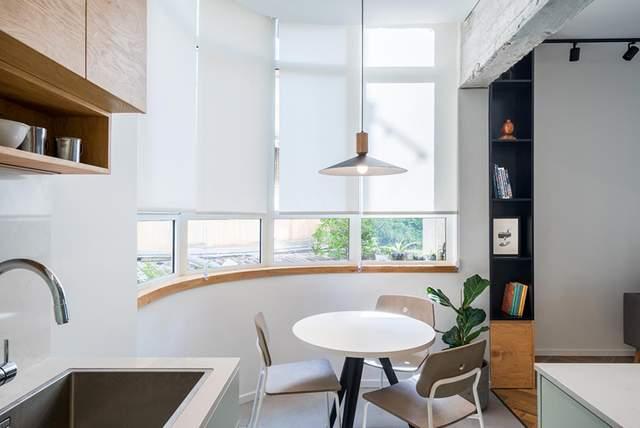 Напівкруглі стіни в кухні накладали свої особливості на дизайн інтер'єру