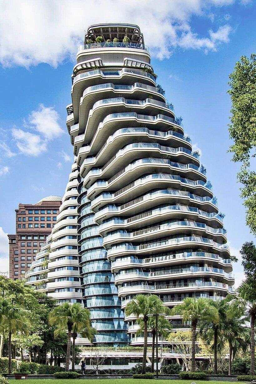 Форма будівлі та дерева гарантуватимуть мешканцям усамітнення  / Фото Designboom