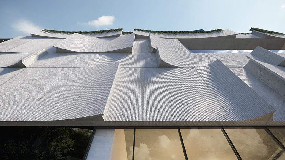 Фасад будівлі нагадує хвилі / Фото Archdaily